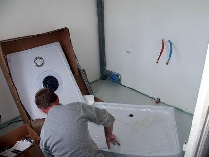 Подготовка душевой кабинки к сборке